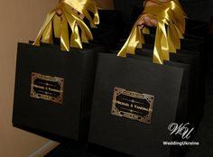 Gatsby style Wedding Welcome Bags for guests with gold satin ribbon handles - Elegant Personalized Paper Bag - Black and Gold Gatsby Theme Custom Wedding Gift bags - Personalized Bag with tag - Paper favor bags - Elegant Art Deco style Paper Bag. Thank your guests for sharing in your special weekend with these Custom Wedding Welcome Bags. Personalized Paper Bag with satin ribbon and tag - Mr and Mrs welcome bag  DETAILS - any quantity of black bags - any color of ribbon - full color digital…