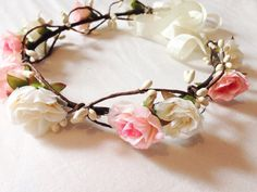 This flower crown features cute pink roses, white pip berries on a vine wire... A woodland feel and very dainty... Ties at the back with
