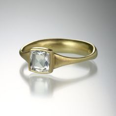 An 18k white gold ring with a rose cut square .68ct white diamond, stone measures 6.5mm x 6.5mm. Size 6.75.