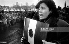 A protest during the Romanian Revolution, The Communist coat of arms has been removed from the centre of the Romanian flag. Romanian Flag, Romanian Revolution, Communism, Coat Of Arms, War, Weapons, Portraits, Image, Weapons Guns