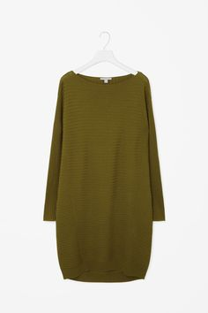 This rib knit dress is made from soft merino wool with a comfortable stretch. A cocoon shape, it has long sleeves, a wide neckline and a tightly knitted hemline