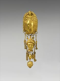 Earring with pendants and female head. Period: Hellenistic Date: 3rd century B.C. Culture: Etruscan Medium: Gold, silver Dimensions: Other: 1 5/16 x 1 1/4 x 4 1/16 in. (3.3 x 3.2 x 10.3 cm)