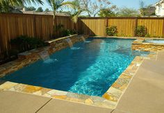 Ledgestone deck coping and sheer descent spillways look great in this backyard swimming pool. If you are thinking about a backyard swimming pool makeover, this could be a great look for your yard. Swimming Pool Pictures, Small Swimming Pools, Small Pools, Swimming Pools Backyard, Swimming Pool Designs, Lap Pools, Indoor Pools, Backyard Pool Landscaping, Backyard Pool Designs