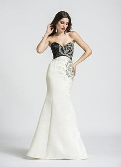 Fall in love with this rosette beaded evening dress. The strapless sweetheart bodice is adorned with glimmering rosettes that flow to the contrasting skirt. The eloquent design flatters the body with a full-length mermaid silhouette.
