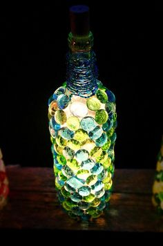 Wine Bottle via Etsy or DIY with Marble accents, seed beads around neck of bottle, painted cork and glowstick or string lights.
