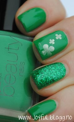 Pretty green polish with a green glitter accent nail and white shamrocks. Perfect for St. Patrick's Day!