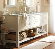 Love every last detail of this bathroom.  Love the wire baskets underneath the vanity.  Love the clear jar filled with soap, etc.  Love how clean and airy this feels.  Love the white wood.