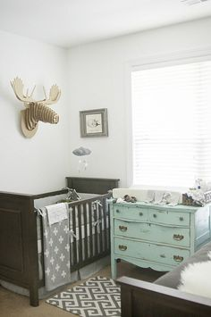Lovely gray nursery - pottery barn crib, cardboard moose, cross blanket, & other amazing details!