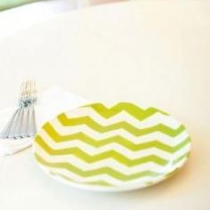 This generously sized dinner plate is the ultimate tabletop accessory. From light bites to banquet nights, the bold chevron pattern and vibrant color of the Green Chevron Dinner Plate brings delicious ambiance to every meal.