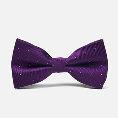 Carefree purple can also look very good on a tuxedo, especially when it is spiced up with a smattering of polka dots. The eye-catching shade of purple on this bowtie with polka dots could only be made better and more appealing with the addition of a similar pocket square.
