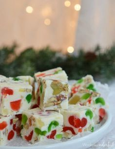 """Fruitcake Fudge Recipe: Candied fruit, pecans, and rum extract make these jeweled bites melt-in-your-mouth amazing (and when was the last time you used """"amazing"""" when talking about fruitcake?)."""