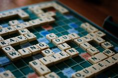 """Do you have an excellent vocabulary, but find yourself losing at online Scrabble to someone who lacks your word mastery? Here are some tips to help """"game the system"""" in playing Scrabble. Jouer Au Scrabble, Board Game Bar, Scrabble Board Game, Scrabble Tiles, Types Of Intelligence, Nos4a2, Classic Board Games, Words With Friends, Toys"""