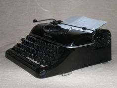 Vintage portable typewriter Optima elite mechanical typewriter by nostalgiehauscom on Etsy https://www.etsy.com/listing/269520411/vintage-portable-typewriter-optima-elite