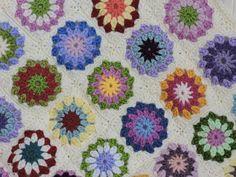 Crochet Baby Blanket in Granny Square Rainbow Rosettes £25.00