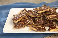 If you don't like to cook and Christmas Candy Recipes intimidate you, you have to try this Saltine Cracker Toffee Candy Recipe. It is so simple and anyone can make it with great results! It doesn't require any cooking thermometer and literally takes minutes to make! And it tastes amazing! It disappears so fast you …