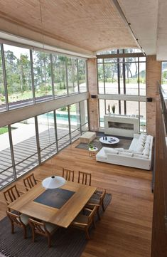 Family House in Medellin by Oscar Mesa - What can I say?!? I have a thing for tall living rooms with lots of glass walls... PS: check out the swimming pool... #House