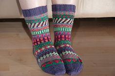 Stranded color work socks, designed to use up leftover scraps of sock yarn.