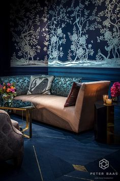 """Ethnic Chic's """" A Blue Corridor"""" installation. The De Gournay designed wallpaper was hand-painted onsite. Silk textiles from Rubelli."""