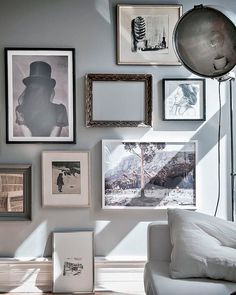 hint of soft romance. beautiful gallery wall with an empty vintage frame.