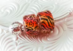 Lampwork Hot Kitty Big Hole Bead Pair Sterling Silver Fully Lined Handmade SRA Artist. $48.00, via Etsy.