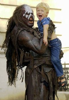 One of my all time fav pics - this little guy gets an exciting on set visit with Lurtz from LOTR ~ in honor of the director's cut marathon I'm watching right now :)