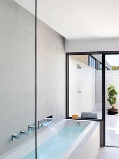bath tub that transitions to outdoor porch/patio hot tub  |  Hotel Sezz Saint-Tropez by Christophe Pillet