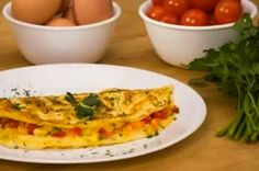The Omelet //   crack them into a bowl, // whisk them up //  the sides go up at an angle //   whipped up eggs, or whisked up eggs // flip it over //  Put your fillings on the top and fold it over