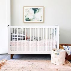 These adorable pom-pom bins are FINALLY back in stock. Get them in 4 colors in the #PNshop. Nursery by @saltboxcollective - can this nursery BE any dreamier?! Great job!