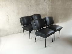 These mid century chairs have an incredible shape with an unusual boxy back…