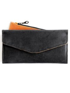 Slim, sleek, and functional, our leather Hailu meets all of your wallet needs. It features 8 card slots + 2 slip pockets that can be used for cash, receipts, or a checkbook. The back exterior pocket c