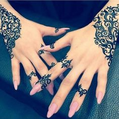 Something like this henna design on my forearm in the style of a bracelet