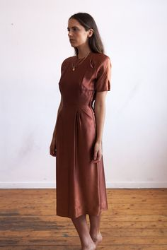 """Provenance Rare late 1930's early 1940s satin day dress. Small shoulder pads, which can easily be taken out. Zips up side for closure. Measurements Bust - 34"""" Waist - 25"""" Hips - 40"""" Length - 43"""" Condition Good antique condition, however, it is being sold AS IS.Noted flaws:Some"""