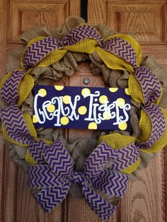 LSU wreath made from burlap and a handmade painted sign saying geaux tigers