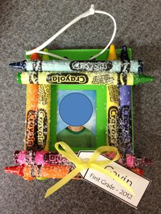 Crayon Picture Frame: This is a super cheap parent gift!  All you need are some crayons, foam for the back, string/ribbon, Mod Podge, glitter, and a student picture.