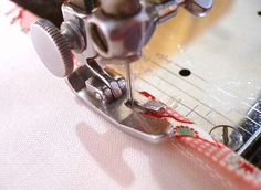 Stitching the bias-binding in place on bound seams.