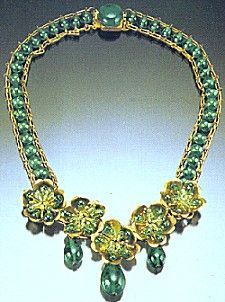 """Emerald green glass beads set in gilded brass flower petals with """"emerald"""" drops and gilded chains by Louis Rousselet, 1948, for couturier Robert Piguet. Stamped """"Made in France"""" on clasp."""