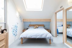 Love the light blue palette, perfect with the light wood...  HomeSphere in Motion Mercury