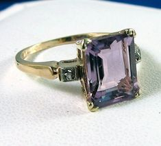 Mine looks almost the same, but without the small stones flanking. Ring was originally a gift to my mom while she was in high school.