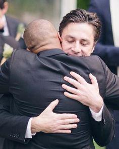 Zach Braff and Donald Faison hugging it out
