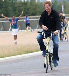 Prince Harry has been seen cycling between venues on his Brompton Bike at Queen Elizabeth park