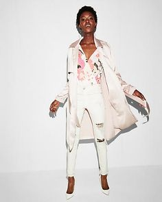 Light draping, silky fabric puts a soft, elegant spin on the classic trench coat silhouette. A sash tie waist maintains an air of timeless charm, so prepare to bring this one out season after season.