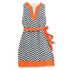 Our classic Game Day Dress is a winner! The sleeveless polyester crepe chevron print dress features a contrasting neckline, hem and removable waist cinching tie belt for versatile style. Measures approximately from shoulder to hem. Part of Mud Pie's G 1950s Fashion, Love Fashion, Dress Fashion, Chevron Print Dresses, Pretty Outfits, Dress Collection, Dress To Impress, Beautiful Dresses, Tablescapes