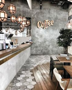 Go for a retro glam bar area complete with luxury hanging pendants, LED lighting and concrete-wall finish for a modern Industrial chic and urban feel. And how awesome is this clever use of flooring – a mix of modern hexagon tiles, paired with wooden panels for a retro look. Go for raw edges with concrete, metal, wood and mirror for a truly urban ambiance. #amazinghomedesignideas #CoffeeArt