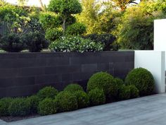 Traditional: Honed bluestone traditional format walling garden wall