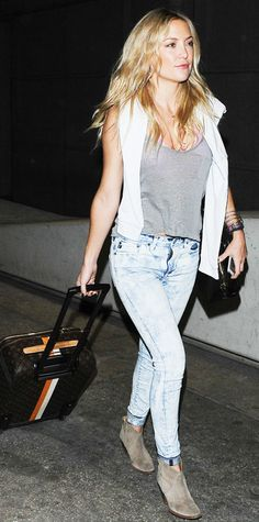 Kate Hudson strolled through LAX in a gray tank and Big Star high-rise jeans paired with taupe booties. A long-sleeve shirt draped across her shoulders topped off the look.