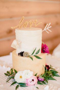Rustic cupid's arrow cake: http://www.stylemepretty.com/south-dakota-weddings/2015/02/24/rustic-south-dakota-state-park-wedding/ | Photography: Jeff Sampson - http://jeffreysampson.com/