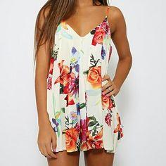 Shop only at brooklimeboutique.com #playsuit #romper #floral #summer #canadafashion #mtl #mtlblog #brooklimeboutique