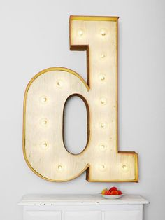 Marquee sign of a letter d for the wall of a child's bedroom.