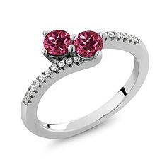 "0.72 Ct Round Pink Tourmaline Two Stone 925 Sterling Silver Ladies Bypass Ring (Available in size 5, 6, 7, 8, 9). ELEGANT- And sophisticated this gorgeous ring promises a carefree and comfortable wear. It's design is meant to accentuate the fingers beautifully. This ring is truly a gorgeous piece that deserves a spot in every jewelry collection. PURE PERFECTION- This ring is perfect for professing your affections for that special someone or as a just ""Thinking of you"" gift. It can be worn…"