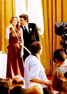 on set at Grey's Anatomy. Ellen Pompeo and Patrick Dempsey.